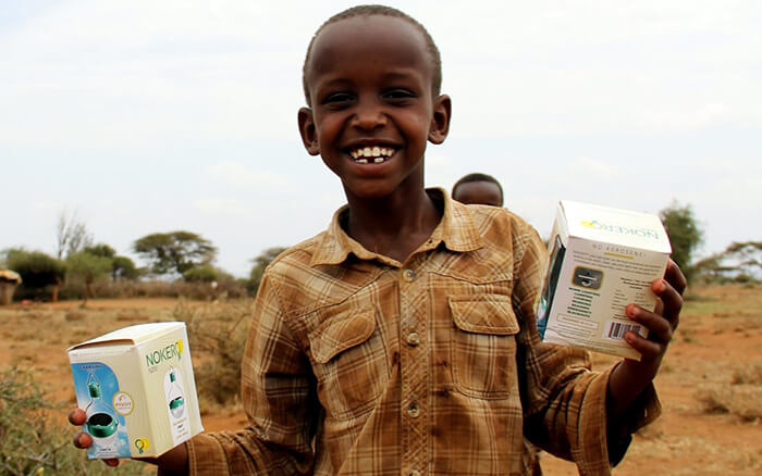 Happy Boy with Nokero Solar Powered Lamp