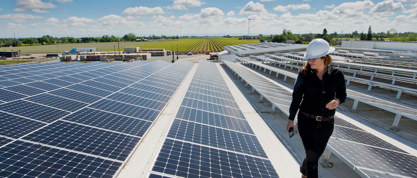 woman inspecting sunpower solar panels