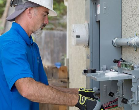 electrician working at power box