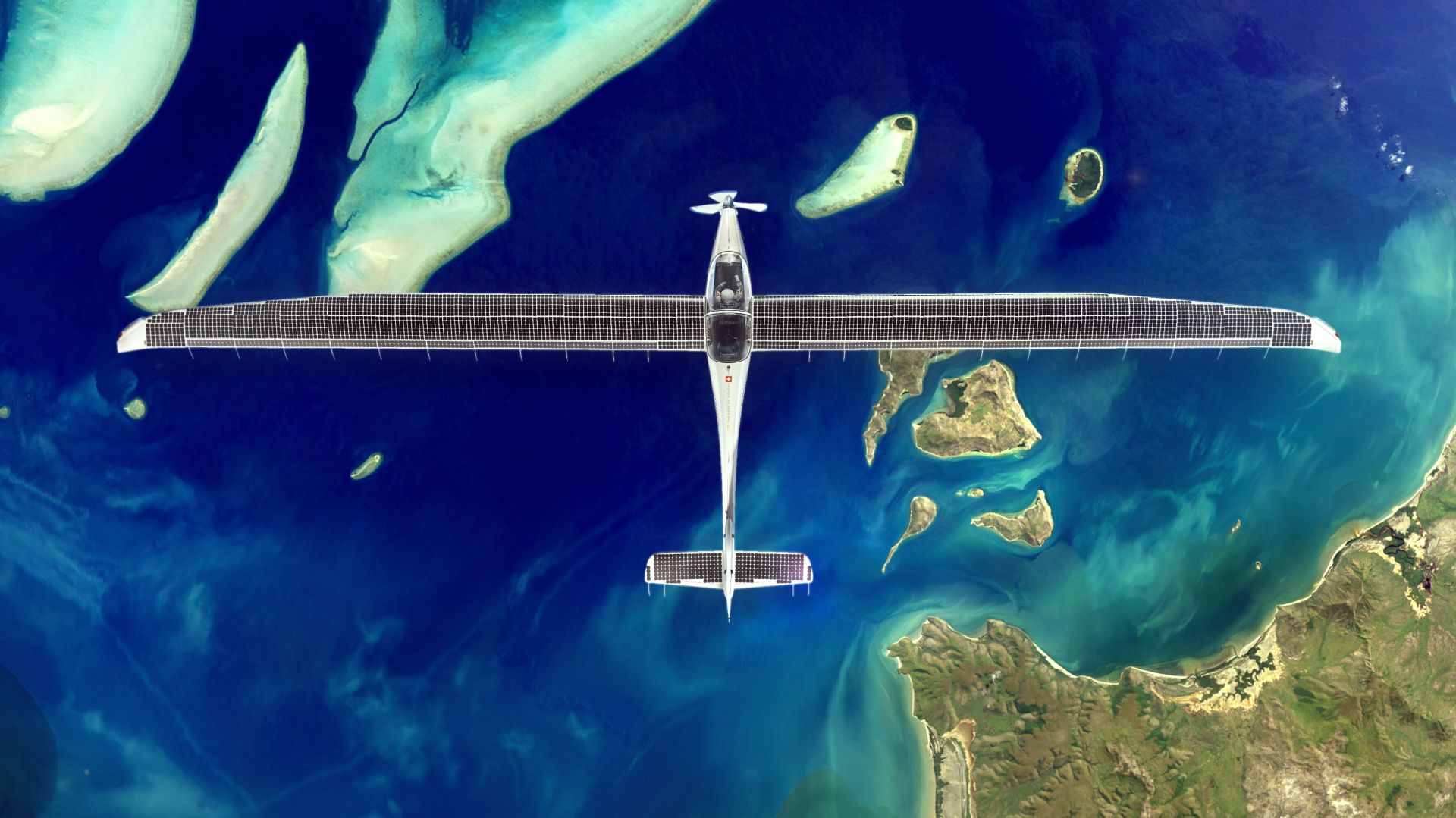 SolarStratos airplane soaring over ocean with SunPower solar cells