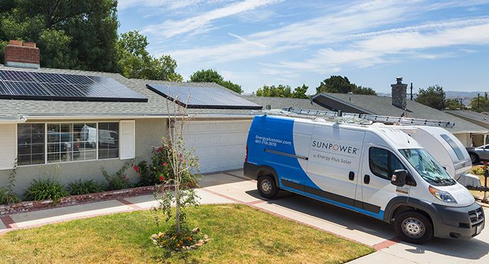 SunPower installer partner van in front of customer home
