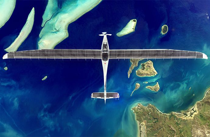 Solar stratos plane flying over blue ocean