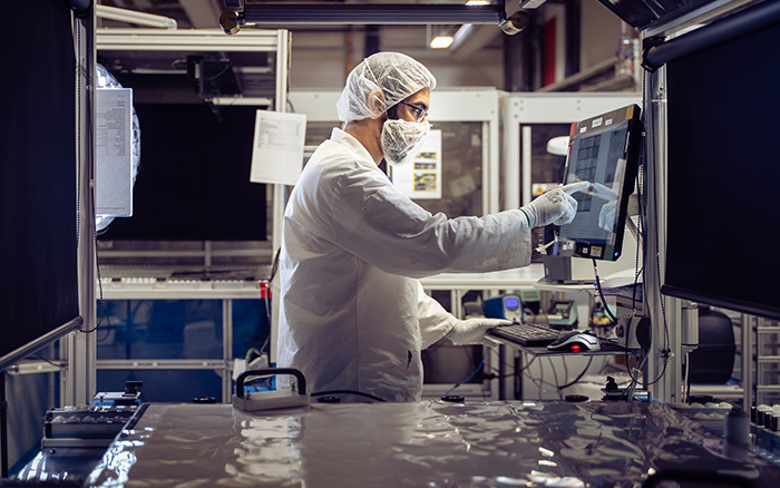 A worker at the SunPower panel manufacturing site in France inspects Maxeon cells