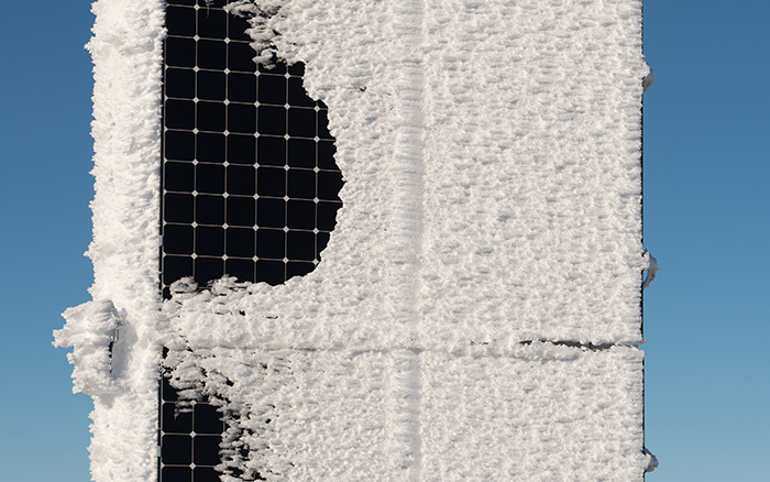 snow covering part of a SunPower Maxeon solar panel