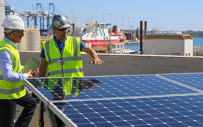 SunPower installation partners on roof of building in Malta