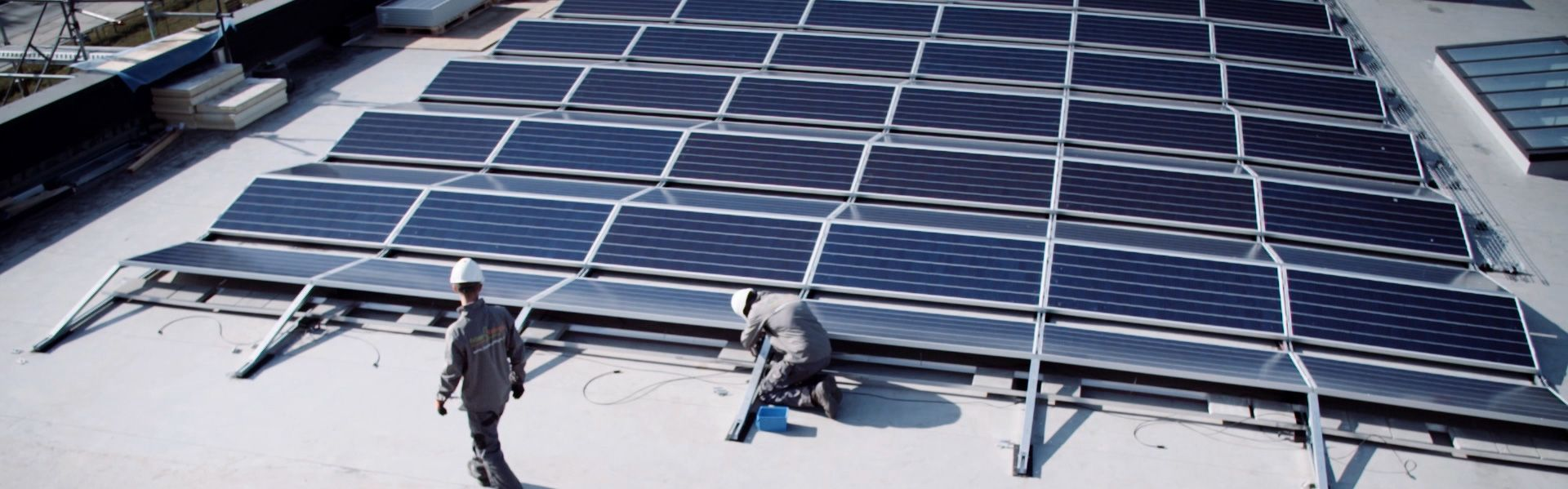 Developers on rooftop by solar panels