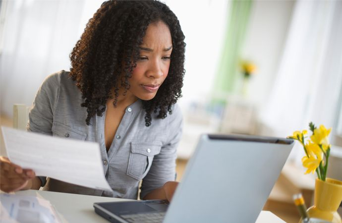 woman at laptop reviewing a utility bill