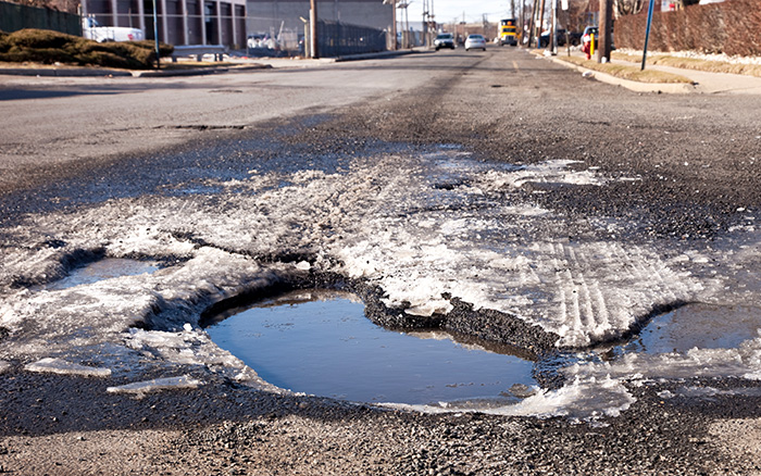pot hole in road created by extreme temperature fluxuations