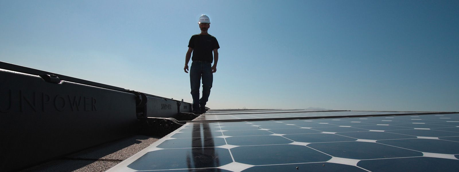 solar installer on rooftop installation